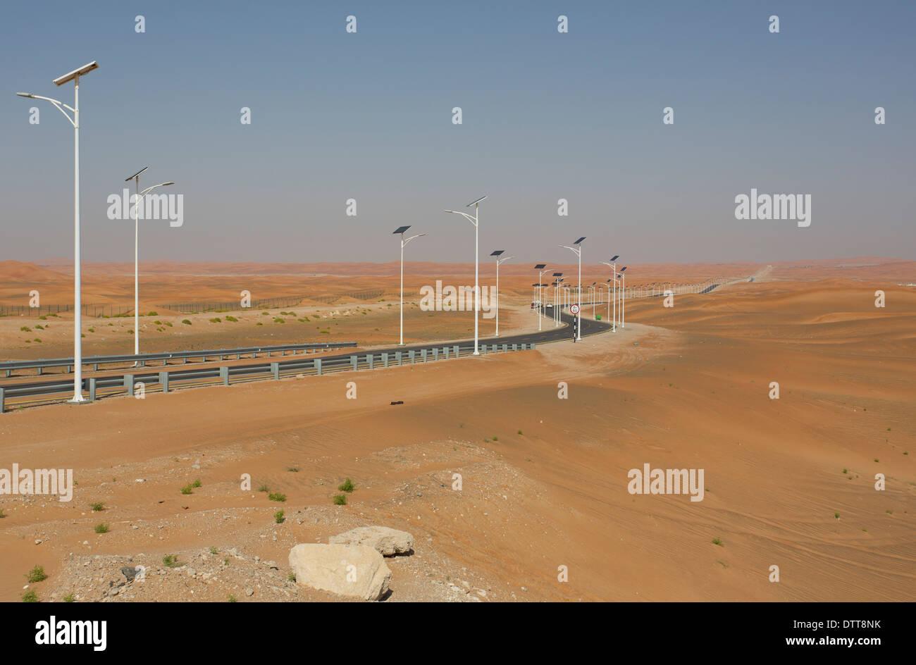 A desert road near Al Ain in the UAE - Stock Image