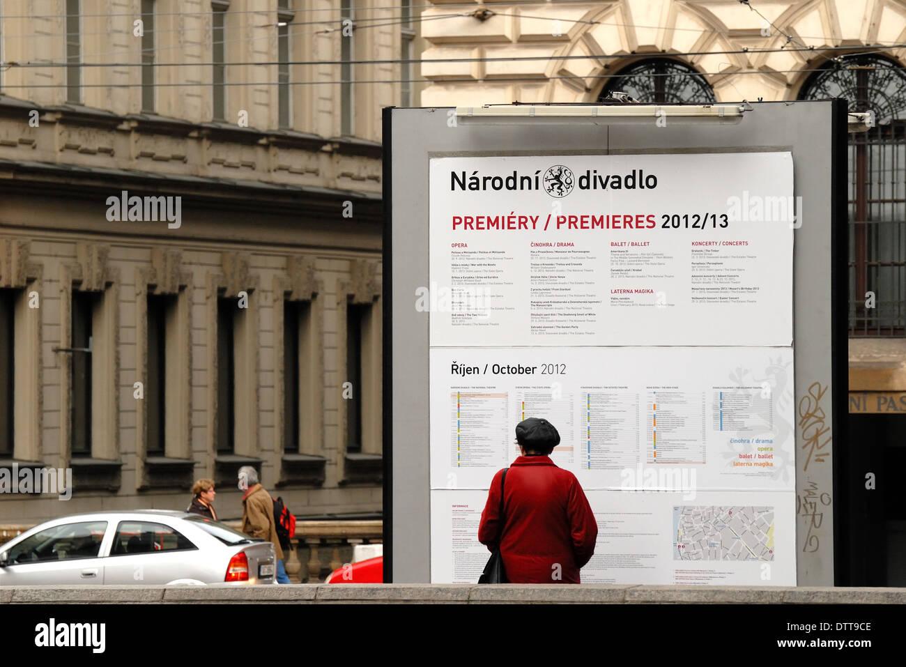 Prague, Czech Republic. Narodni (street) Woman looking at National Theatre programme - Stock Image