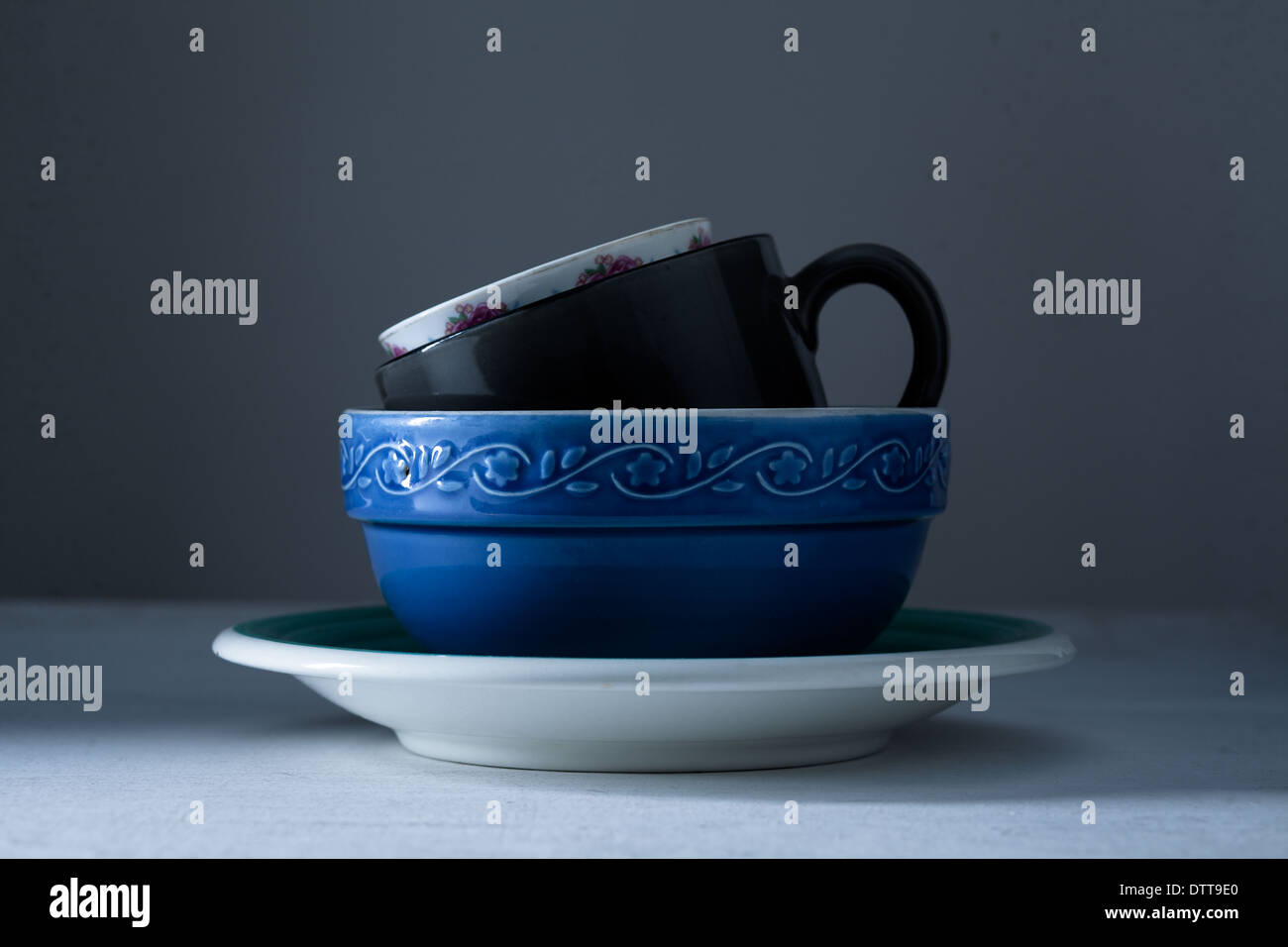 Stacked Cups on Gray Background - Stock Image
