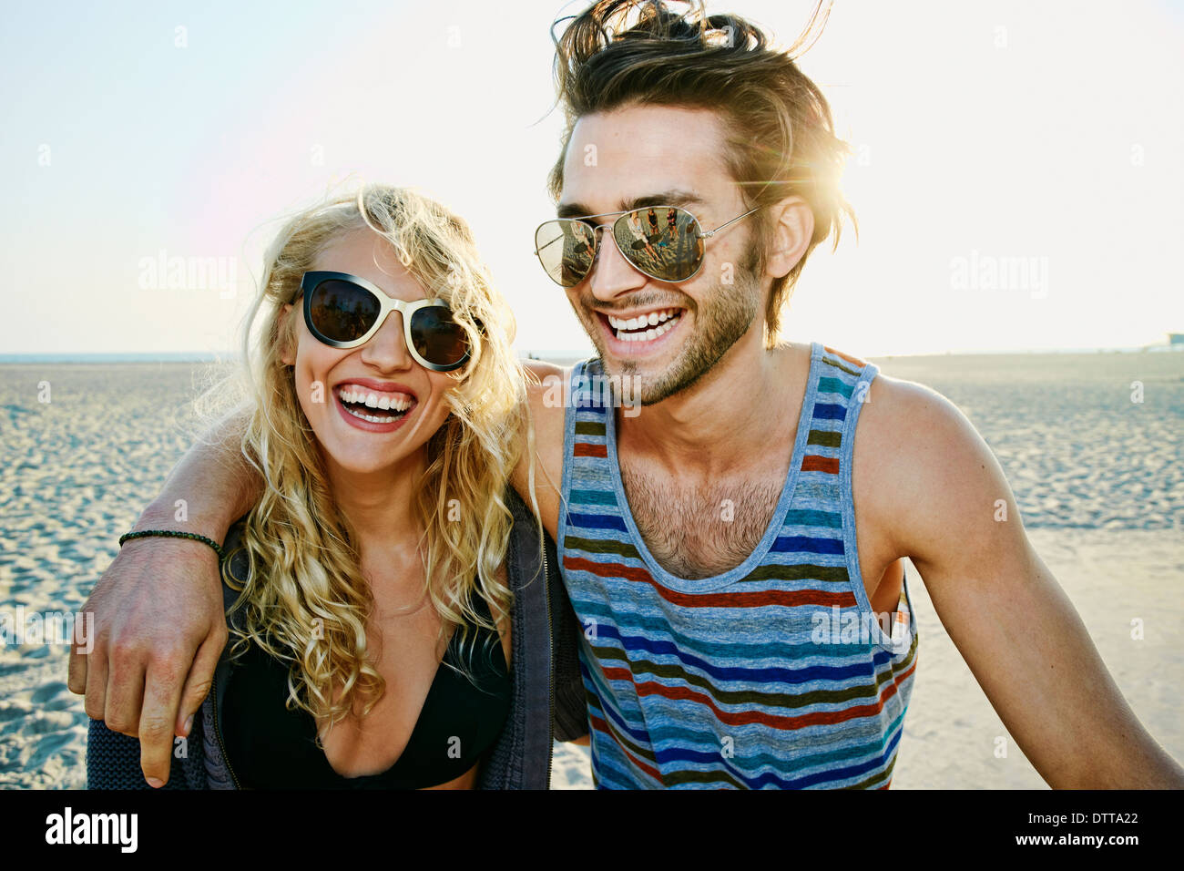 Couple smiling together on beach Stock Photo