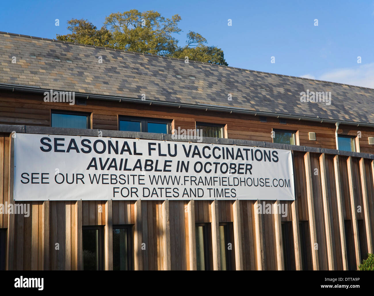 Seasonal flu vaccinations available poster sign on Framfield health centre, Woodbridge, Suffolk, England - Stock Image