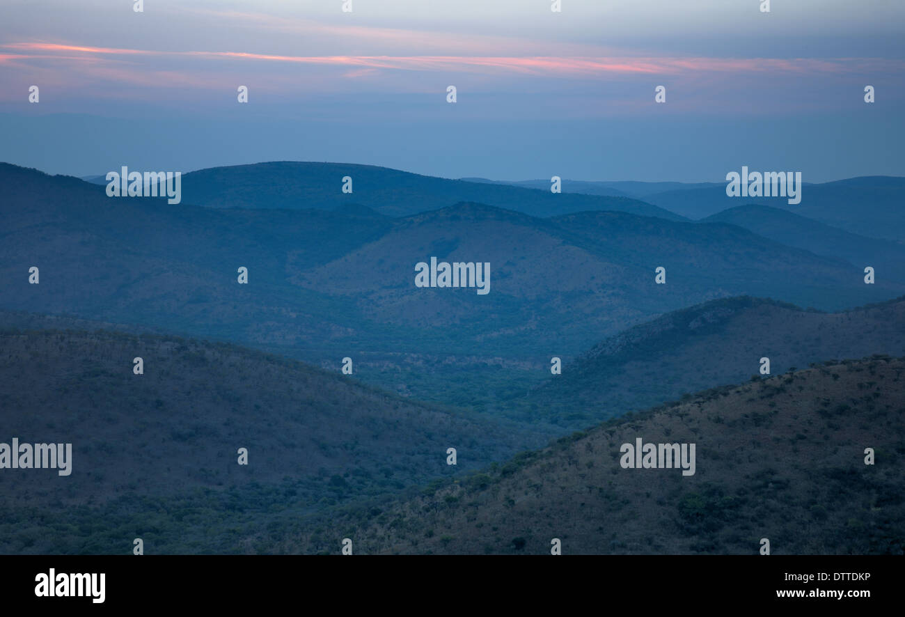 Dusk sky over hills and valleys, Thanda Game Reserve, Kwazulu-Natal Province, South Africa Stock Photo