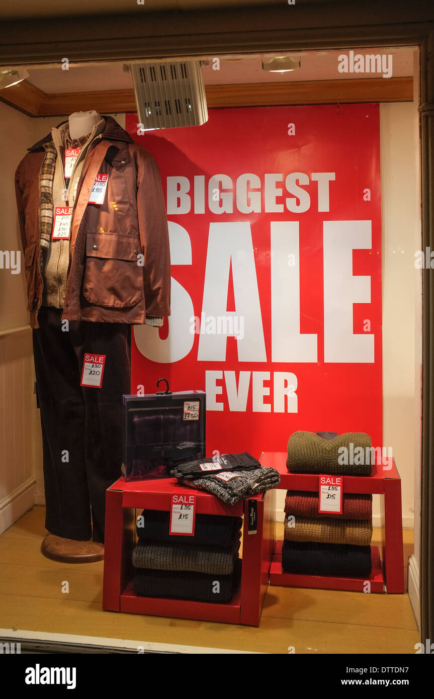 Biggest Sale Ever poster in shop window - Stock Image