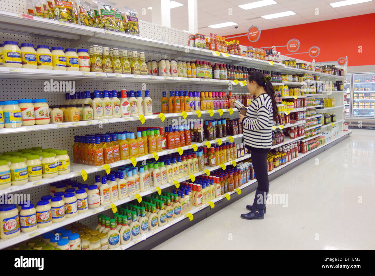 7395609a7e9 Woman choosing products at a supermarket in Toronto, Canada Stock ...