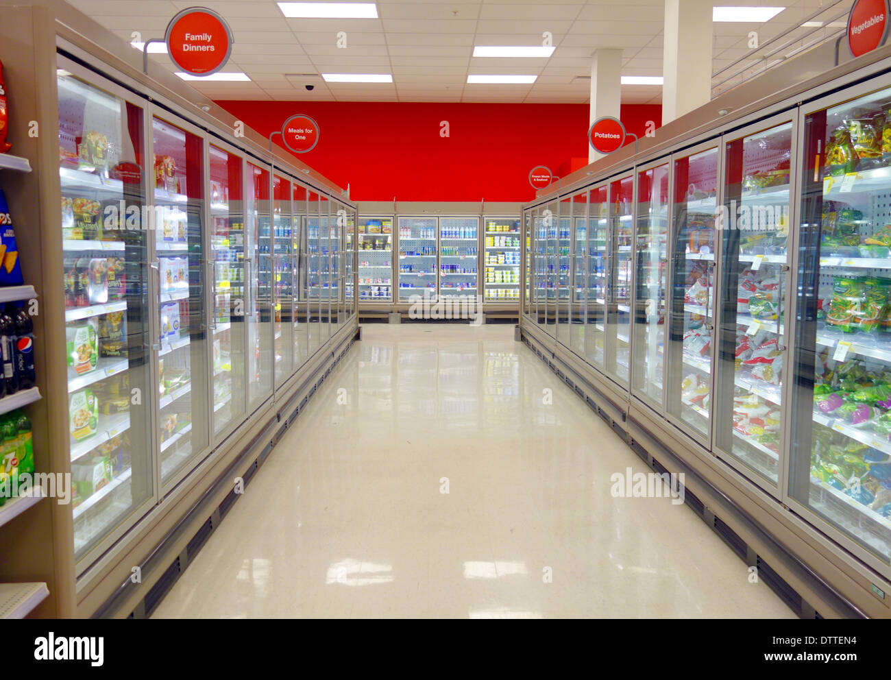 Frozen food aisle and refrigerators in a supermarket in Toronto, Canada - Stock Image