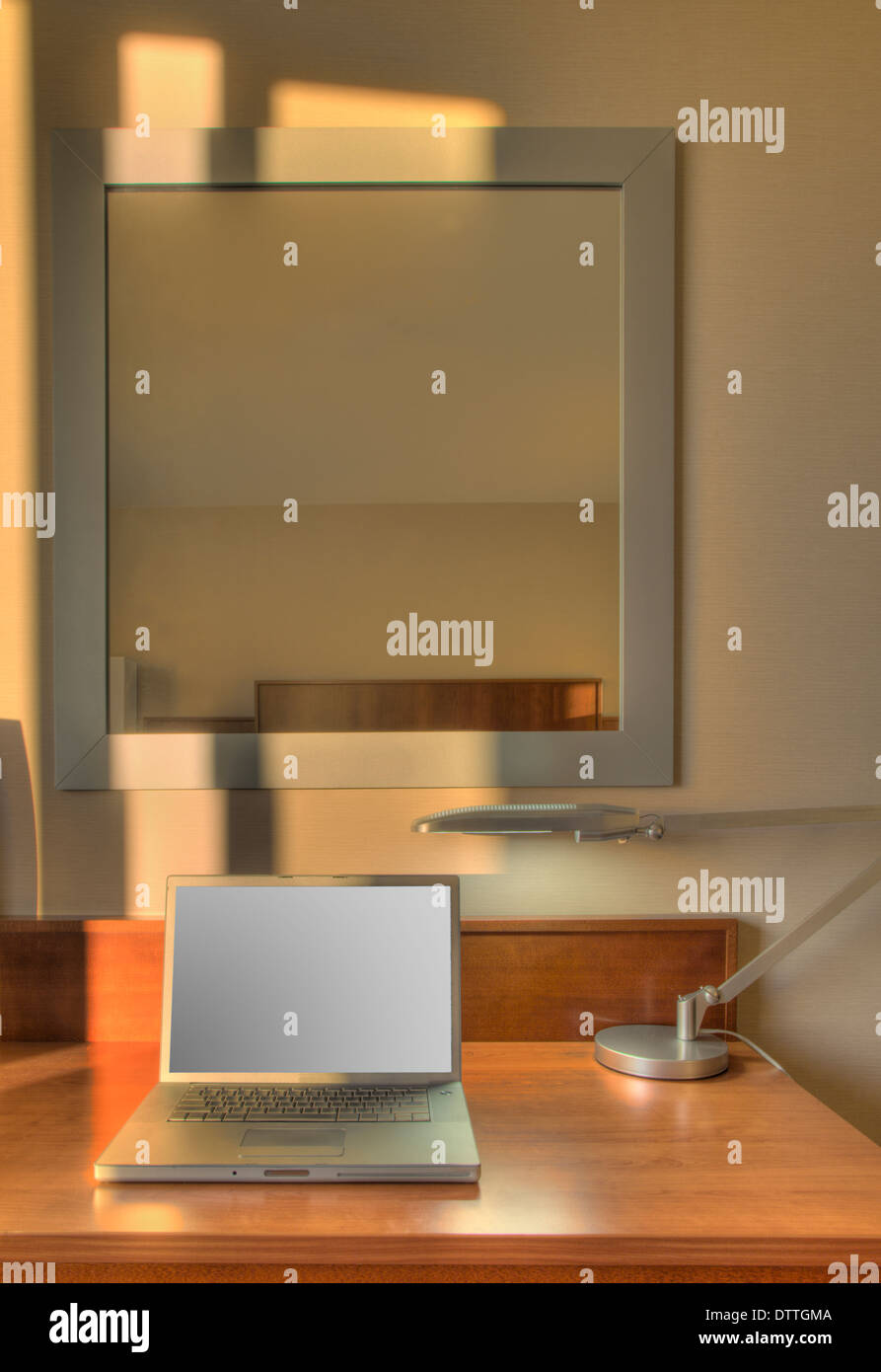 Laptop on desk in hotel room - Stock Image