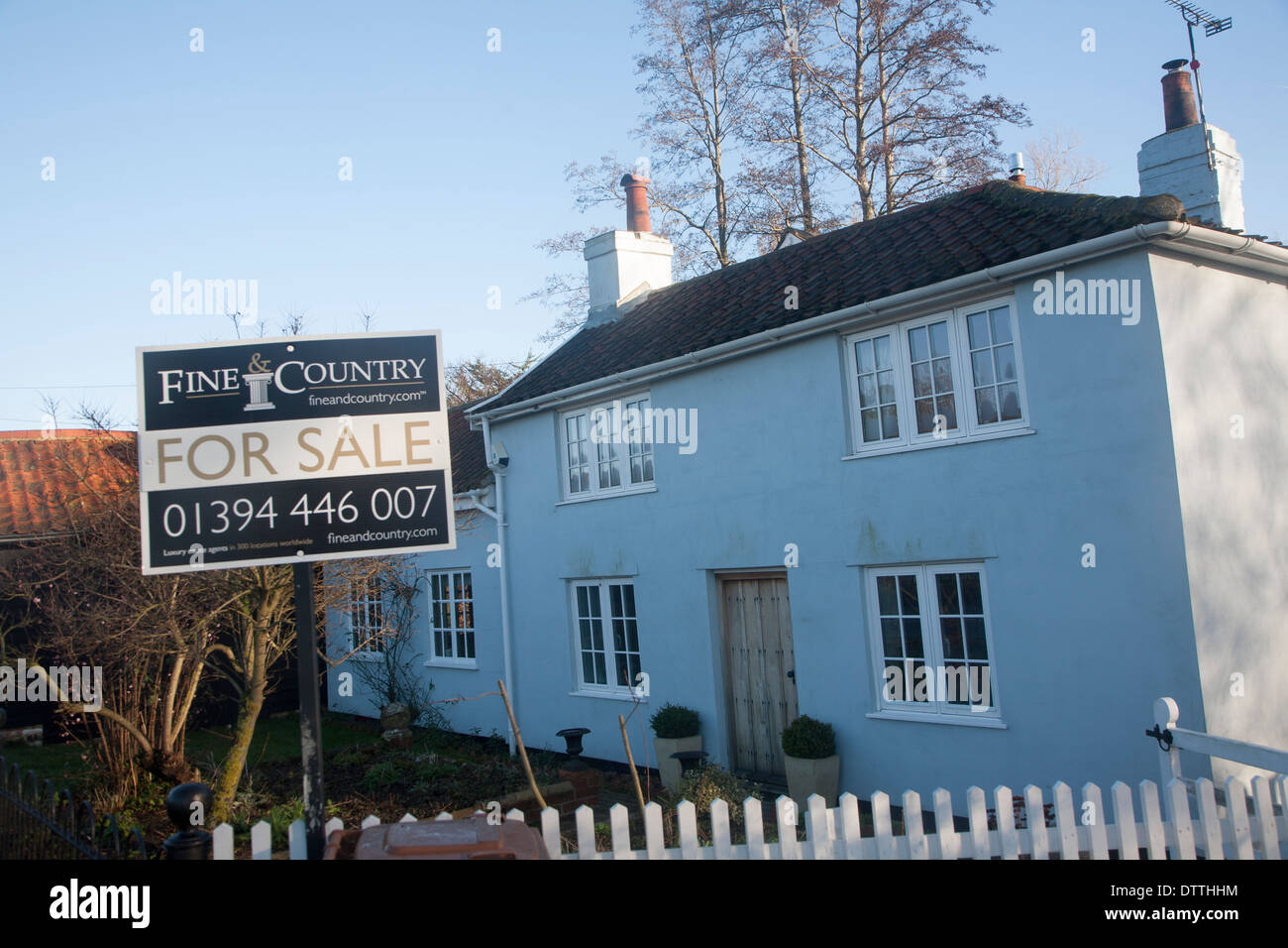 Fine and Country estate agent for sale sign outside detached rural house, Suffolk, England - Stock Image