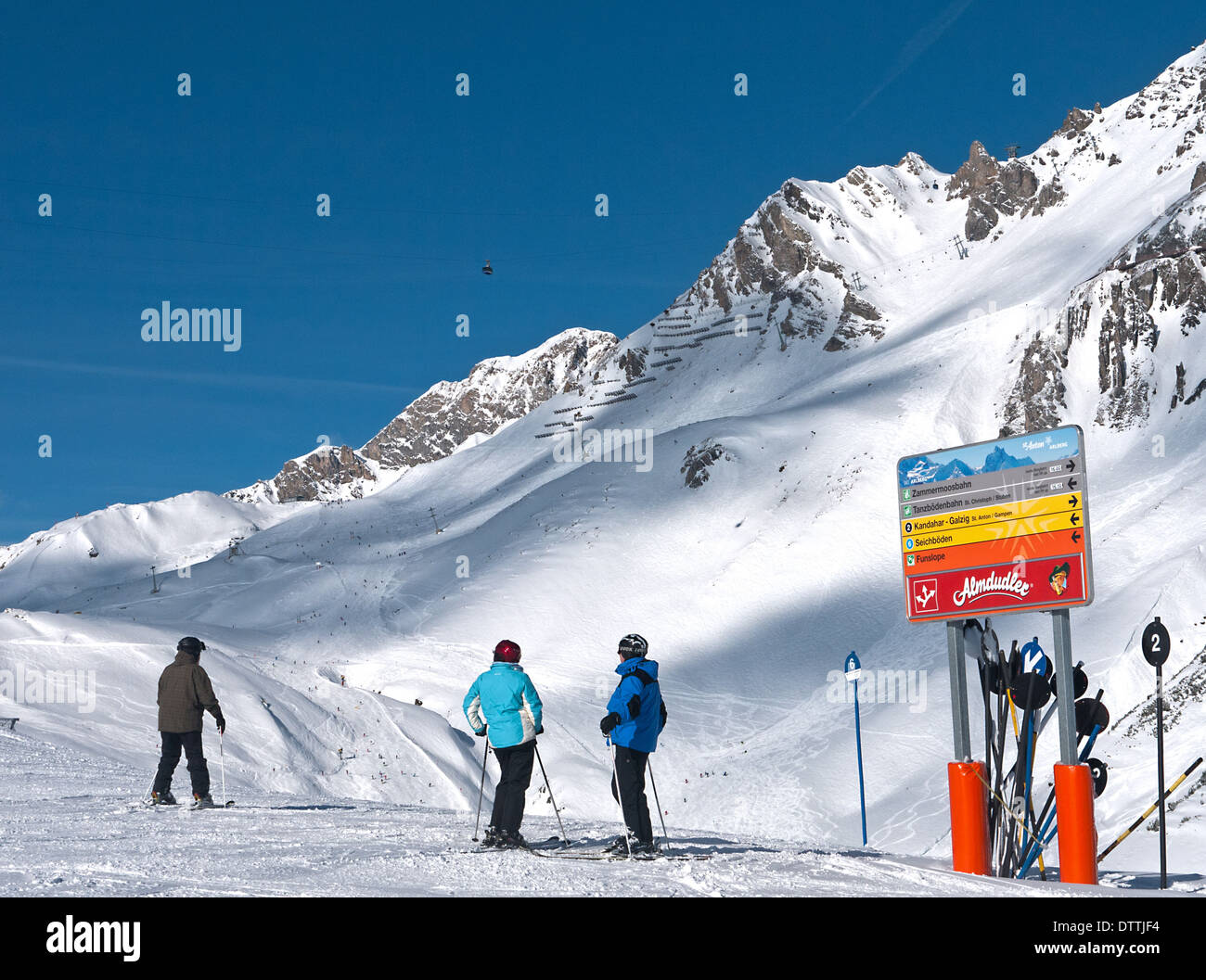Beautiful sky blue day on the pistes of St Anton looking towards the Valluga lift and Steissbachtal ski run - Stock Image