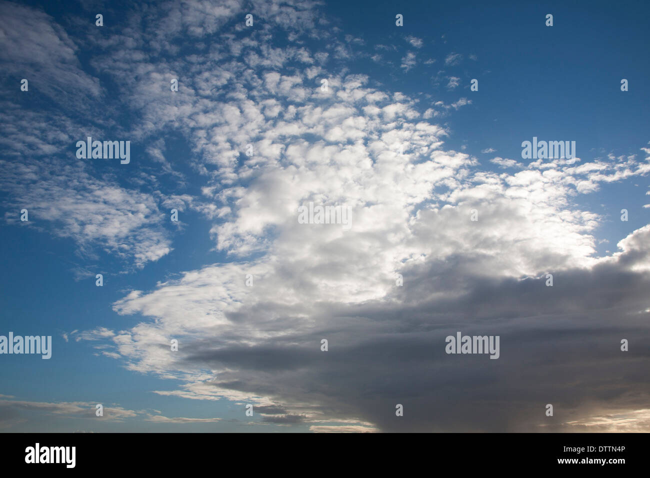 Frontal clouds moving over the sky blocking out the sun at Suffolk, England - Stock Image