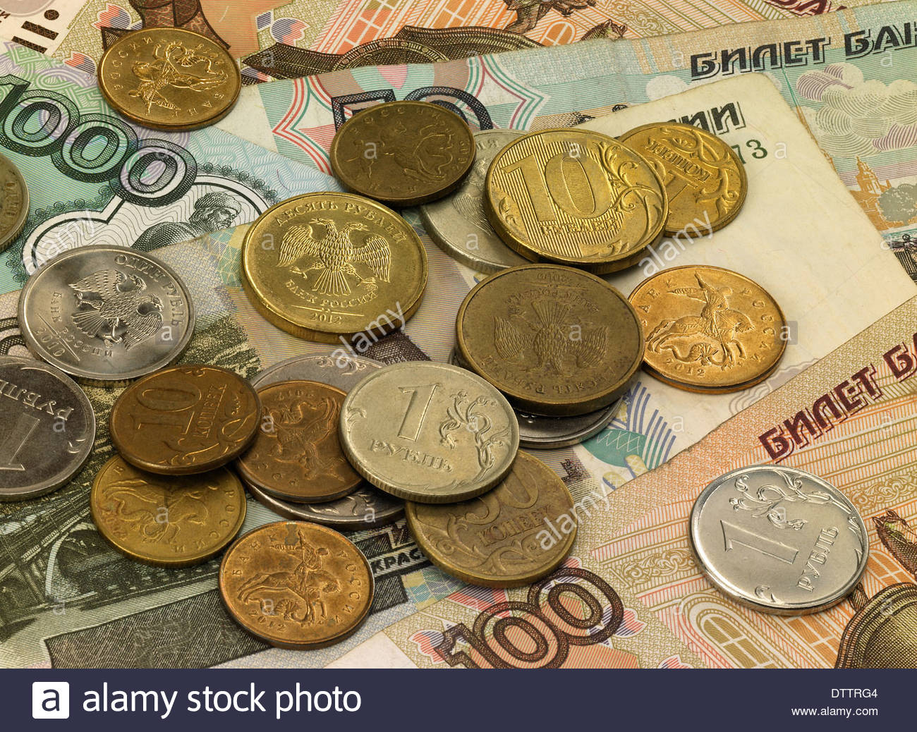 Oblique shot of Russian notes and coins laid out flat on tabletop. - Stock Image