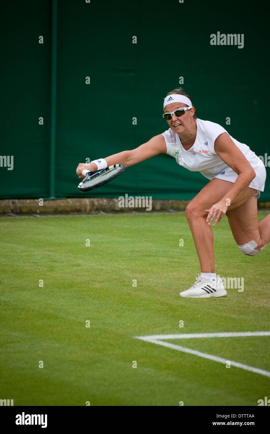 female tennis player returning shot at Wimbledon tennis championship - Stock Image