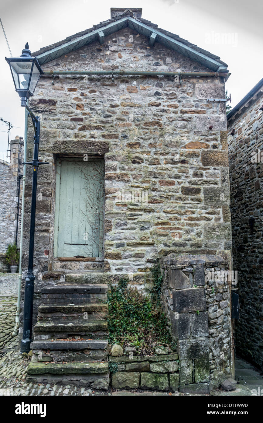 Old stone cottage with steep steps leading to door Stock Photo