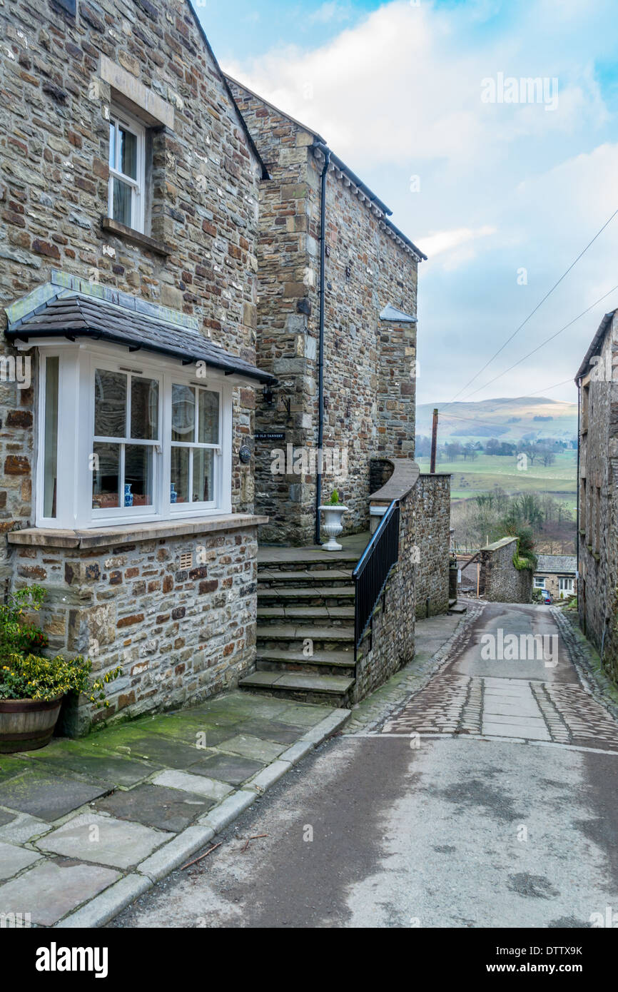 Stone built cottage with steps leading up to front entrance Stock Photo