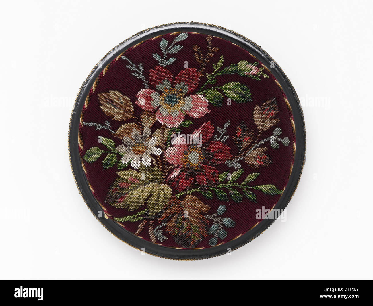Footstool with detachable floral beaded needlework cushion, c.1850-1900. - Stock Image