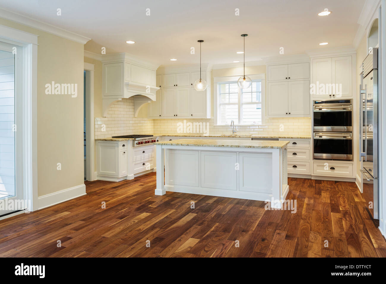 Island and counters in luxury kitchen - Stock Image