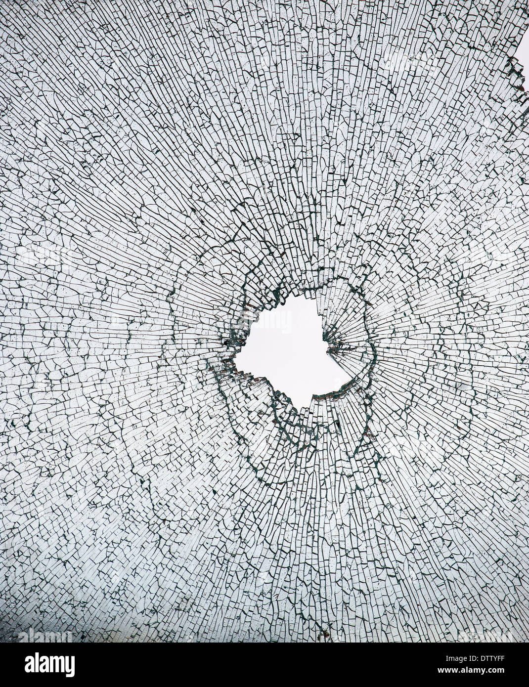 Close up of a shattered window - Stock Image