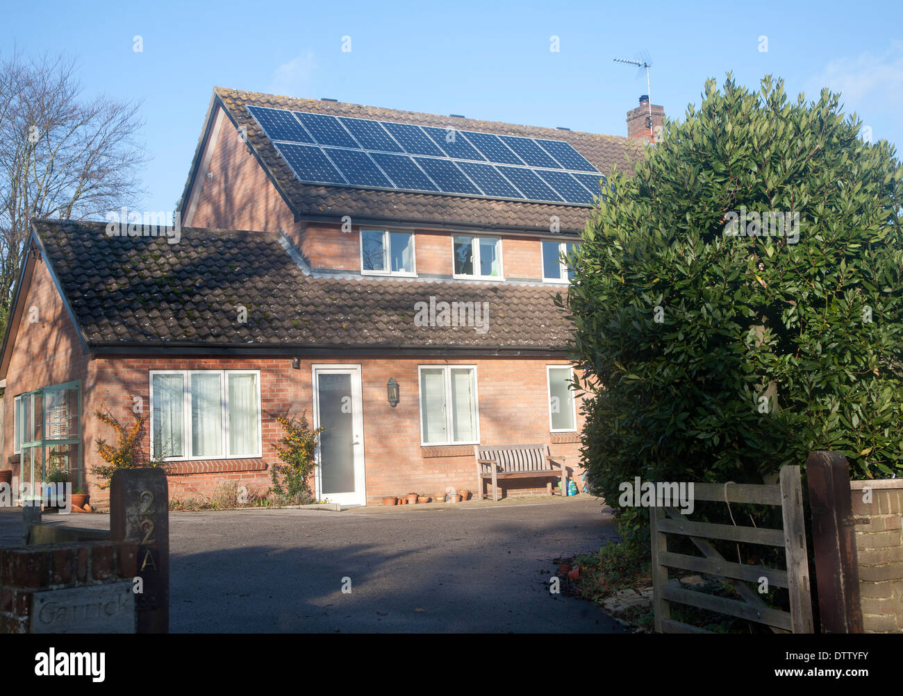Solar panels on roof of residential property in Woodbridge, Suffolk, England - Stock Image