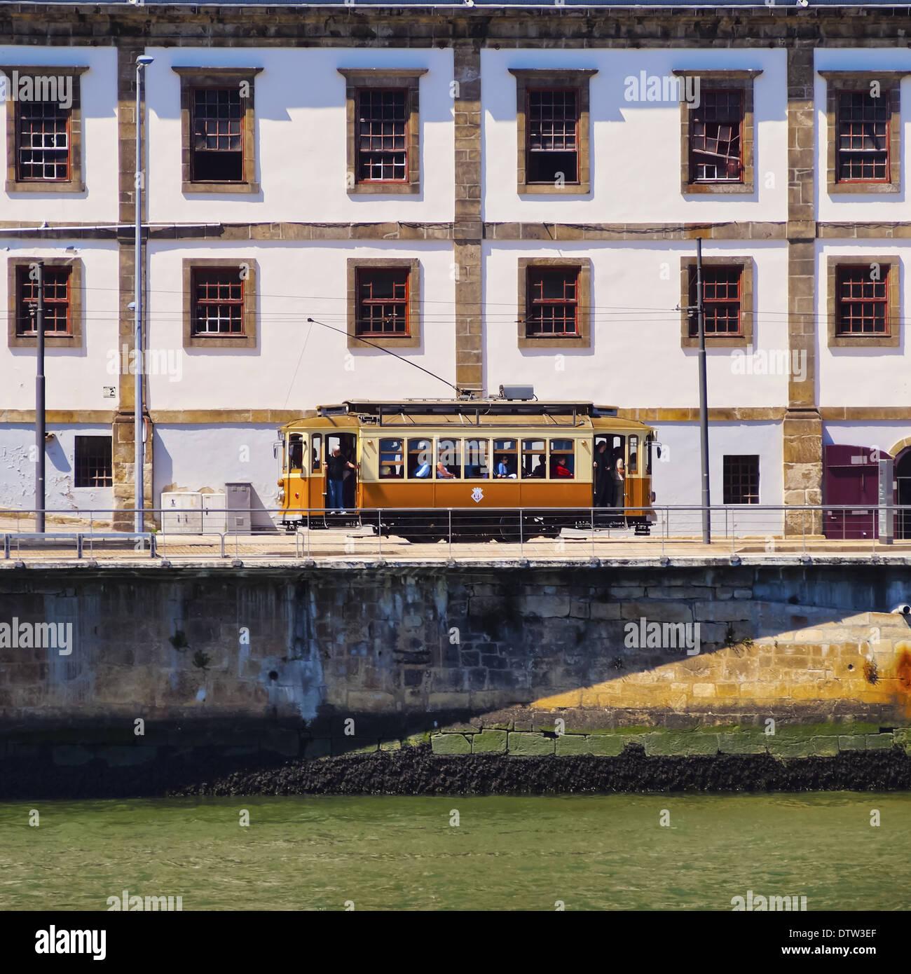 Passeio Alegre Number 1 Tram going along the Douro River in Porto, Portugal - Stock Image