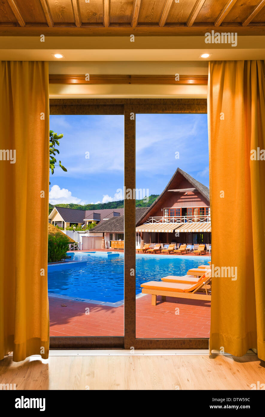 Hotel room and water pool - Stock Image