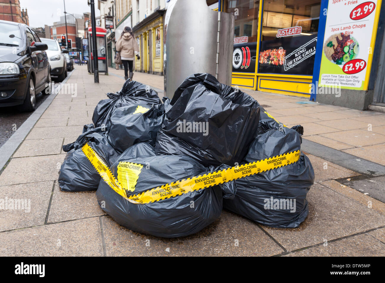 Environmental crime scene. Illegal fly tipping of rubbish bags on a Sheffield city centre street, England, UK - Stock Image