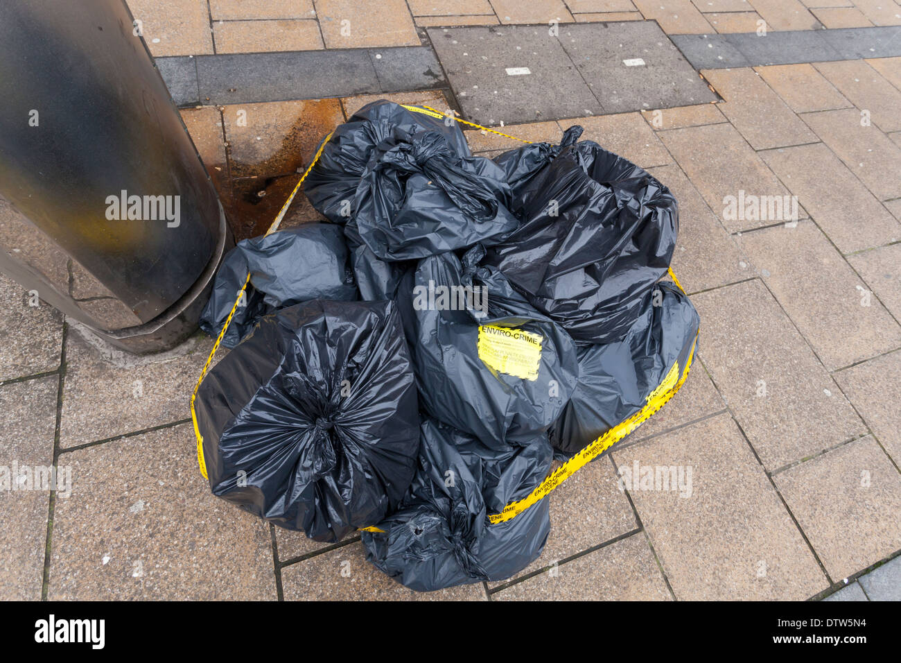 Environmental crime scene. Fly tipping or illegal dumping of waste. Bags of rubbish left on a street in Sheffield city centre, England, UK - Stock Image