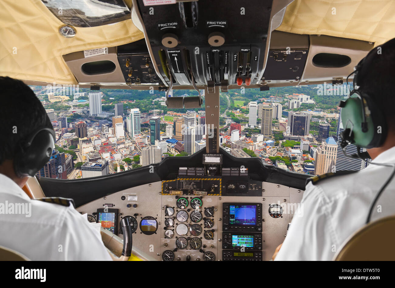 Pilots in the plane cockpit and city - Stock Image