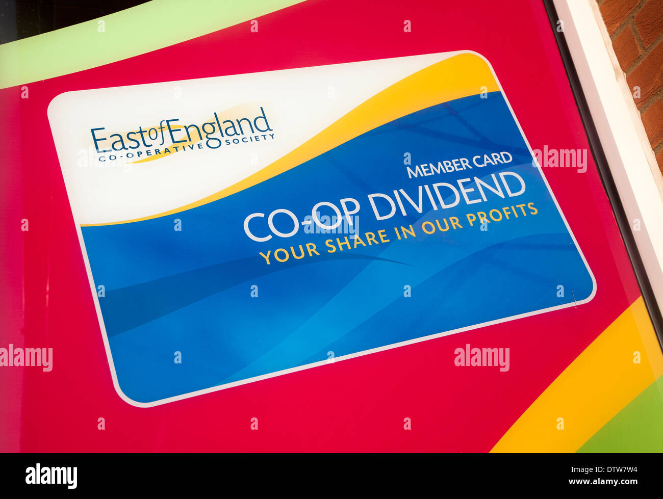 Co-op dividend profit share scheme advertised in shop window, East of England Co-operative Society, Suffolk, England - Stock Image