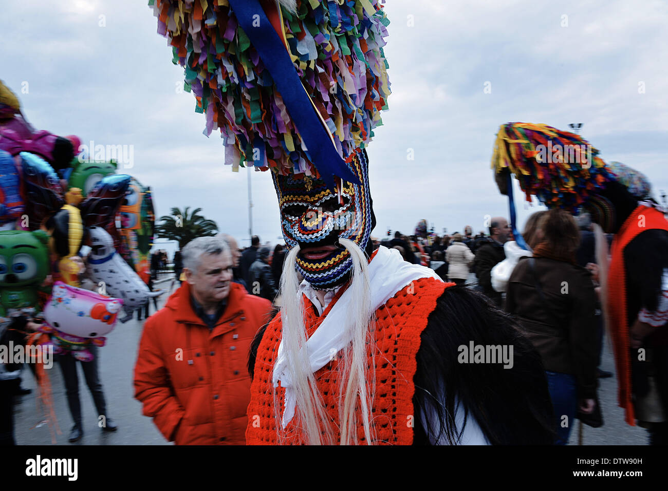 Thessaloniki, Greece. 23rd Feb, 2014. A bell bearer dances during the parade on the seaside avenue of Thessaloniki. Stock Photo