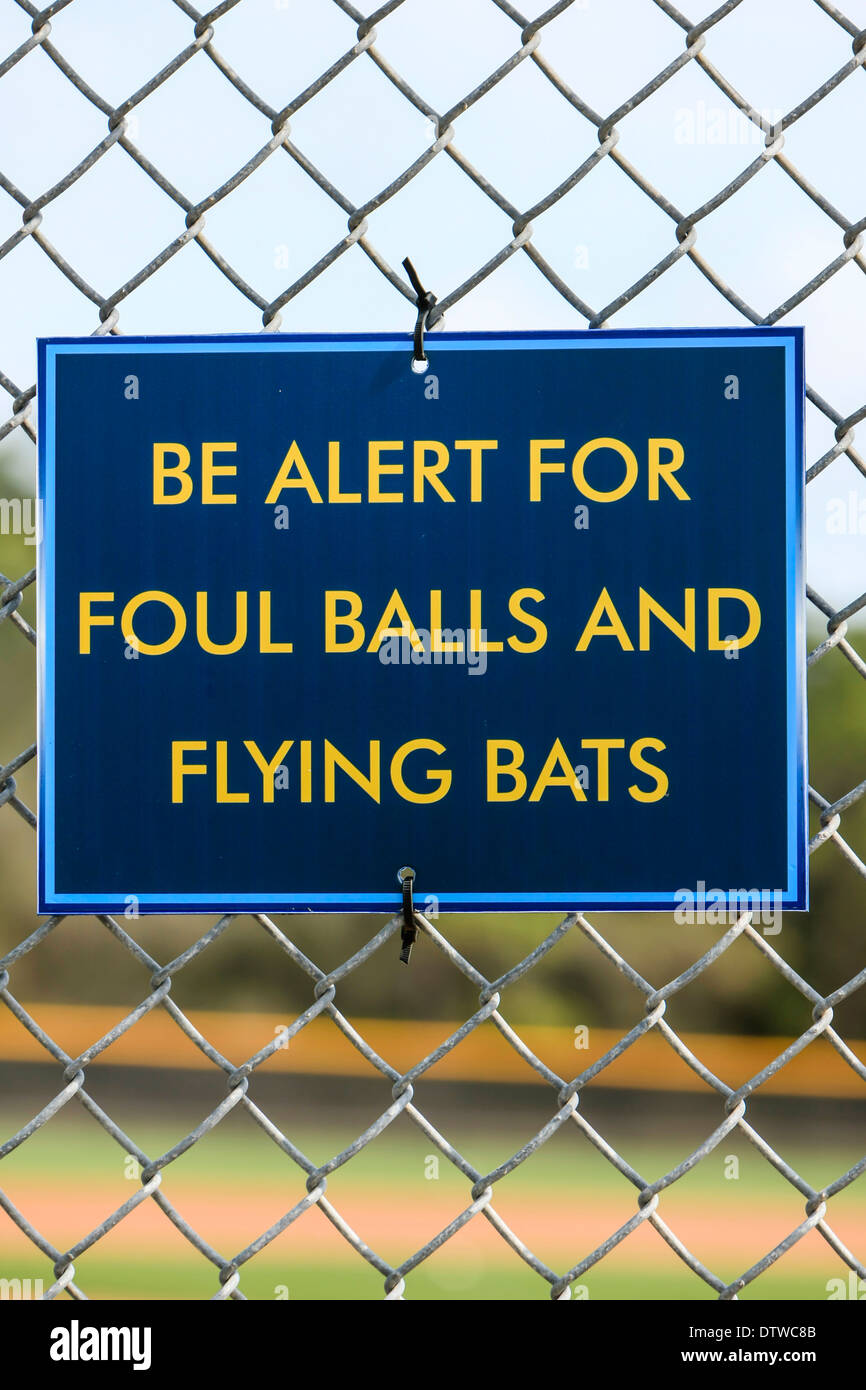 Sign: Be Alert for Foul Balls and Flying Bats - Stock Image