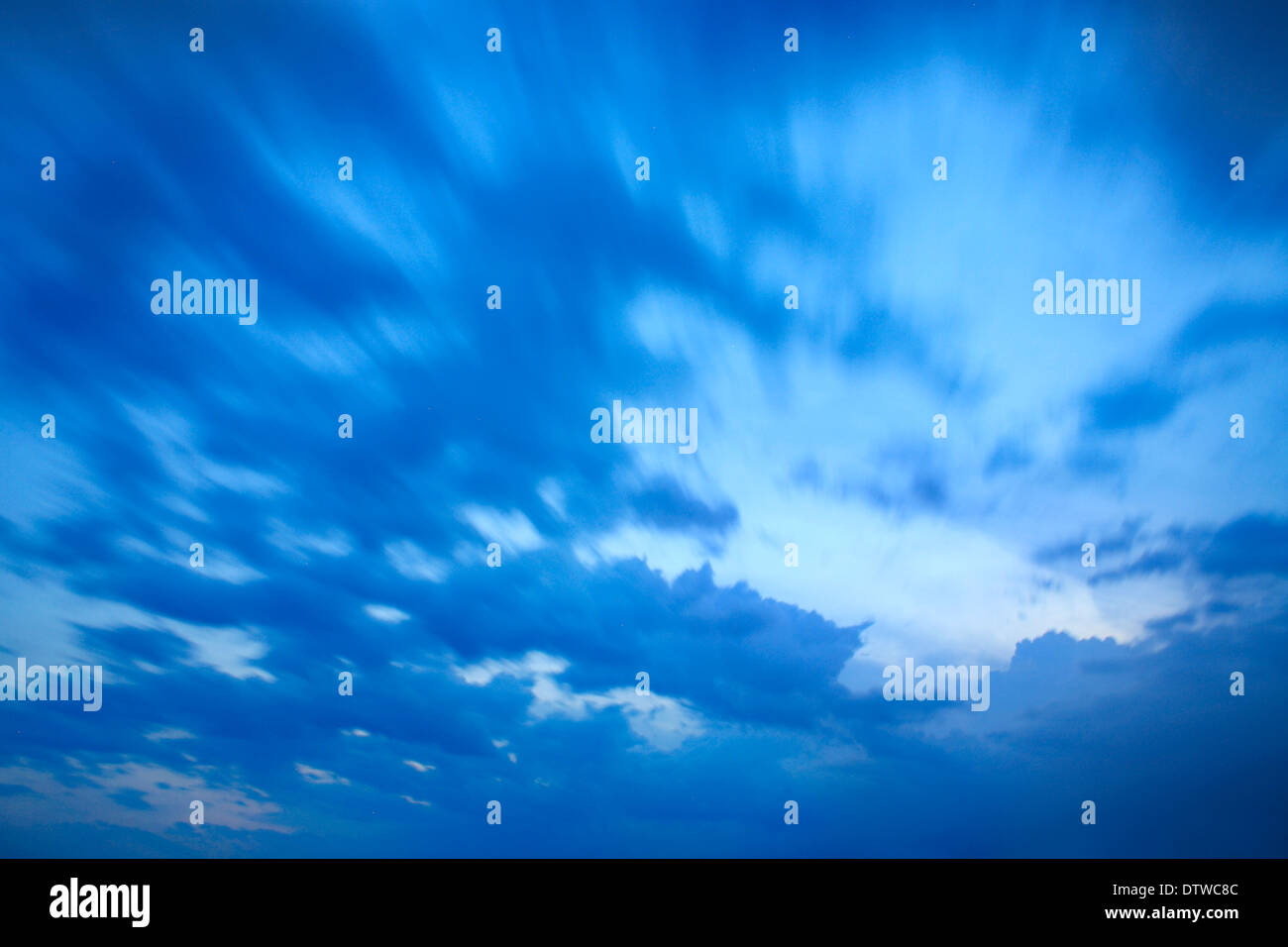 Sky And Cloud Scene, A Blue And Restive Twilight Cloudscape In Motion Blur - Stock Image