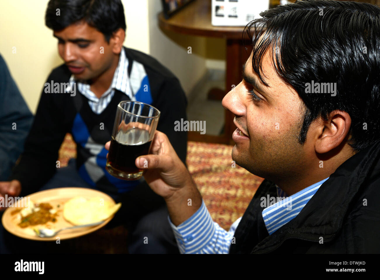 Friends,men,boy,people,Indian,Party,partying,drink,drinking,food,happy - Stock Image
