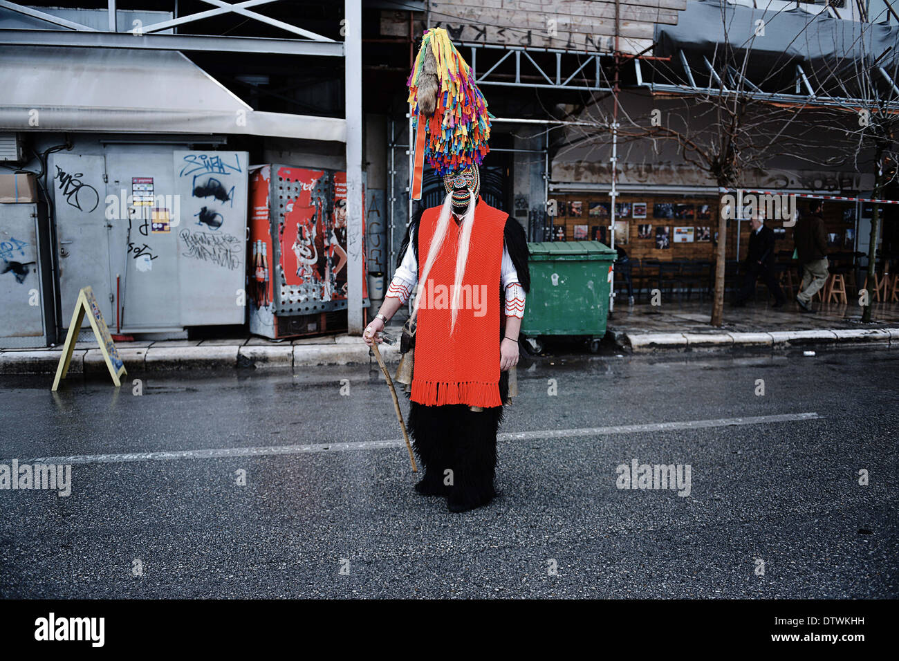 Thessaloniki, Greece. 23rd Feb, 2014. A bell bearer parades on the seaside avenue of Thessaloniki. The Folklife Stock Photo