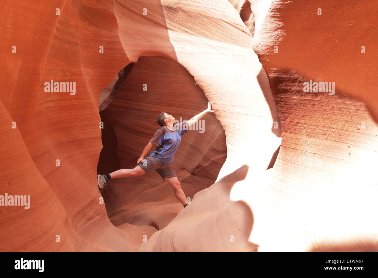 Climber in canyon Stock Photo