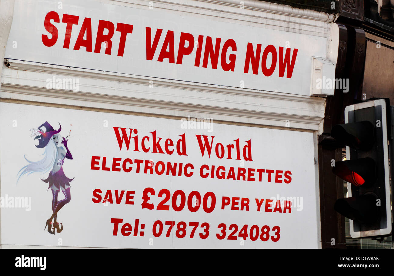 Man walking past  a shop selling e-cigarettes in Derbyshire, England, UK - Stock Image