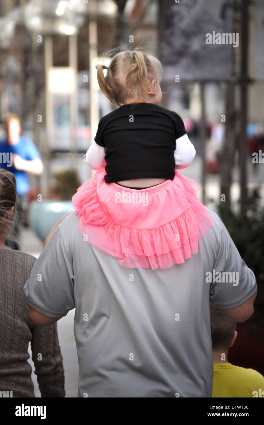 man carrying small girl on shoulders Stock Photo: 66950560