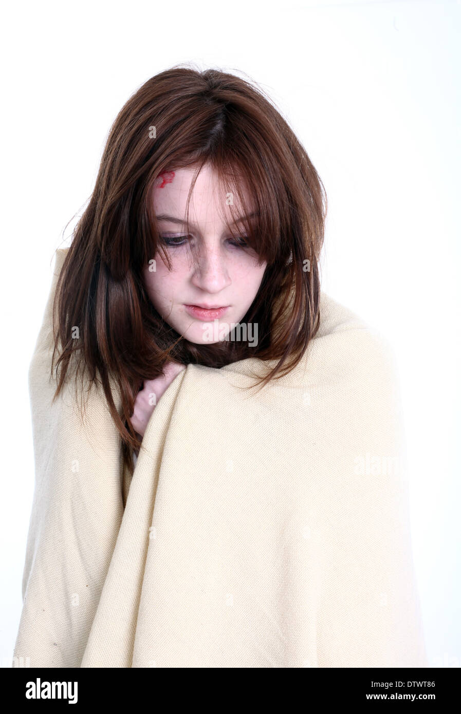 Young female model in the studio role playing as a survivor of a natural disaster, November 2013 - Stock Image