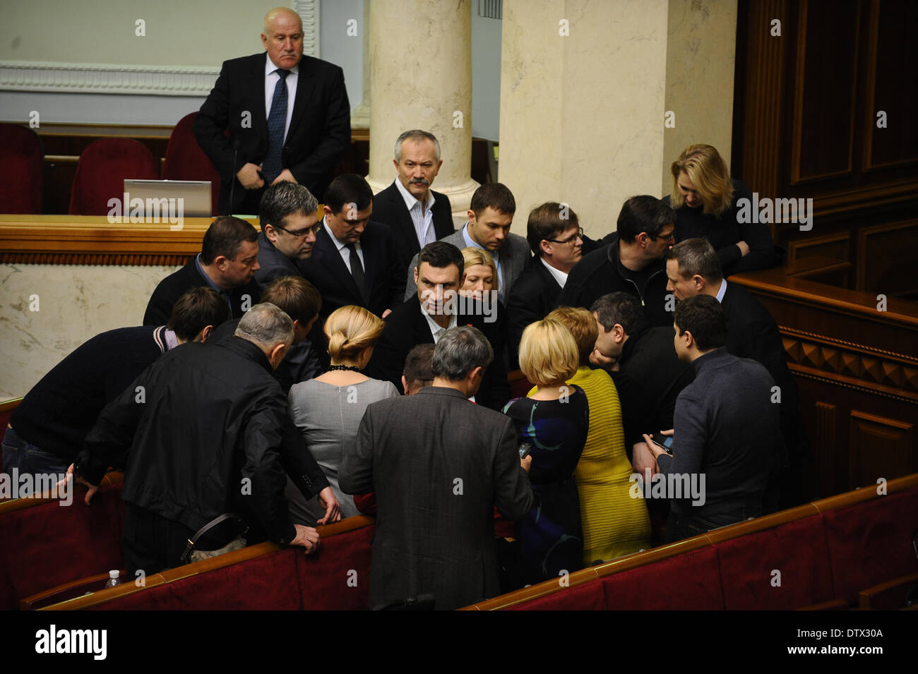 Kiev, Ukraine. 24th Feb, 2014. Ukrainian political opposition leader Vitaly Klitschko (C) talks with lawmakers before a session at the parliament in Kiev, Ukraine on Feb. 24, 2014. Credit:  Dai Tianfang/Xinhua/Alamy Live News - Stock Image