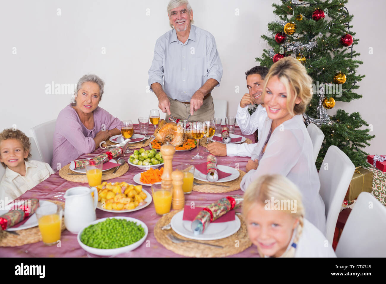 Happy family at christmas dinner - Stock Image