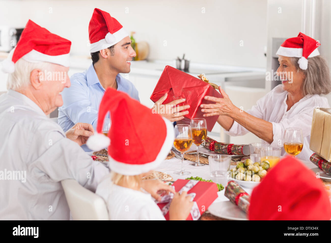 Happy family exchanging christmas gifts - Stock Image