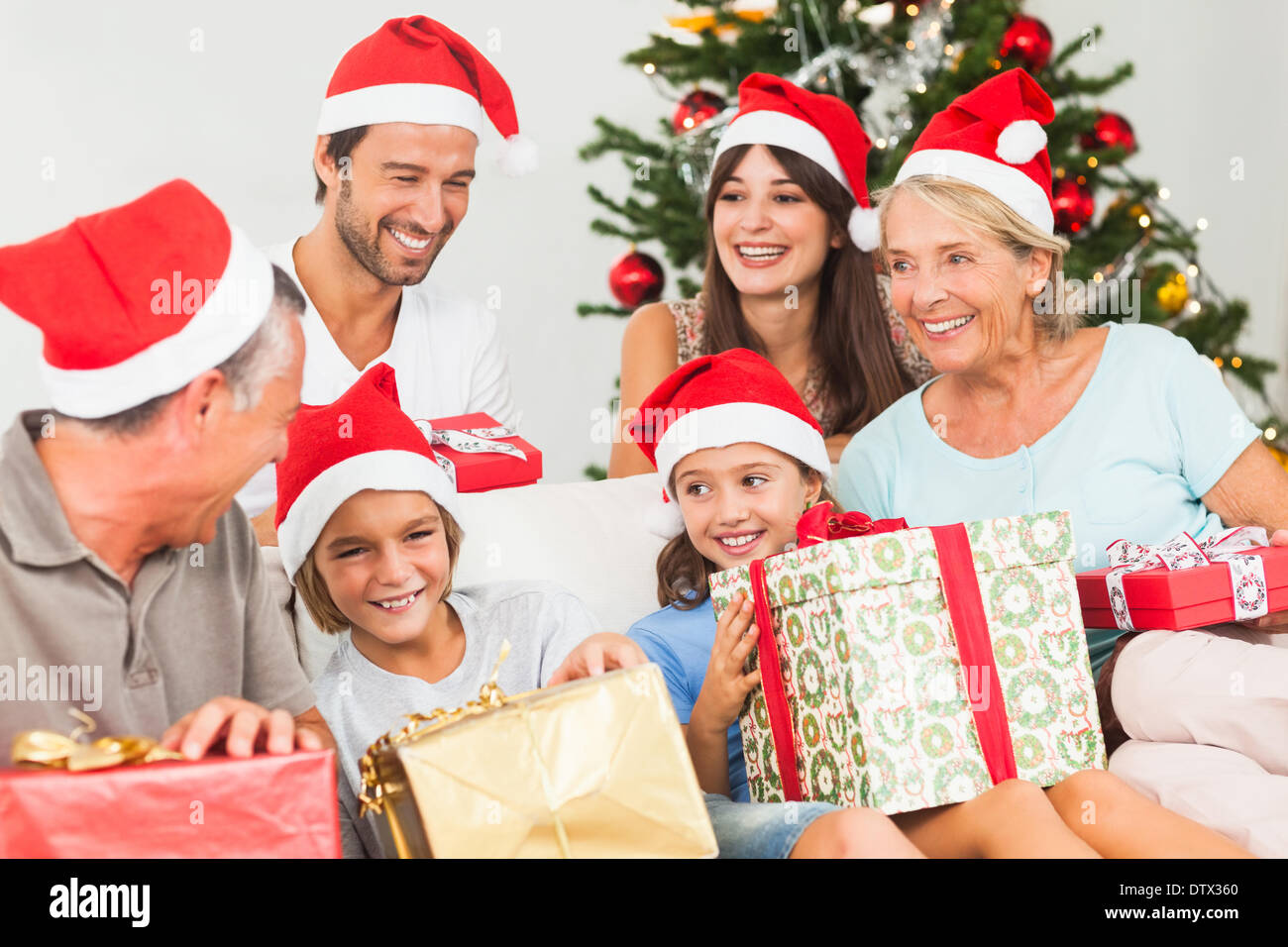 Happy family at christmas swapping gifts - Stock Image