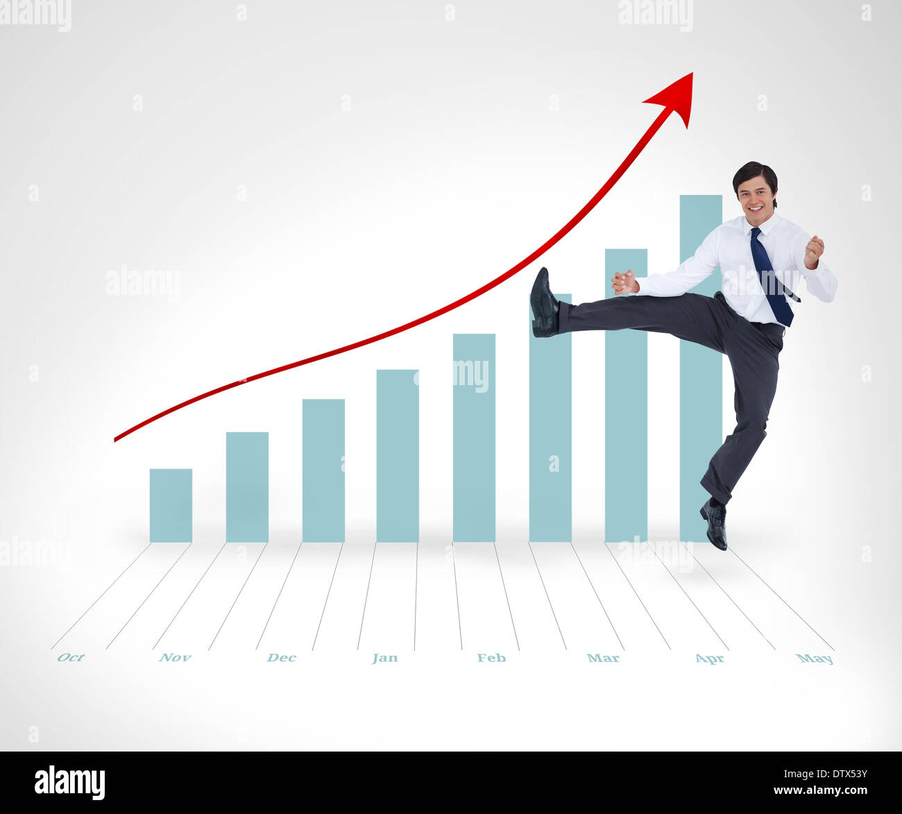 Businessman bouncing against a background - Stock Image