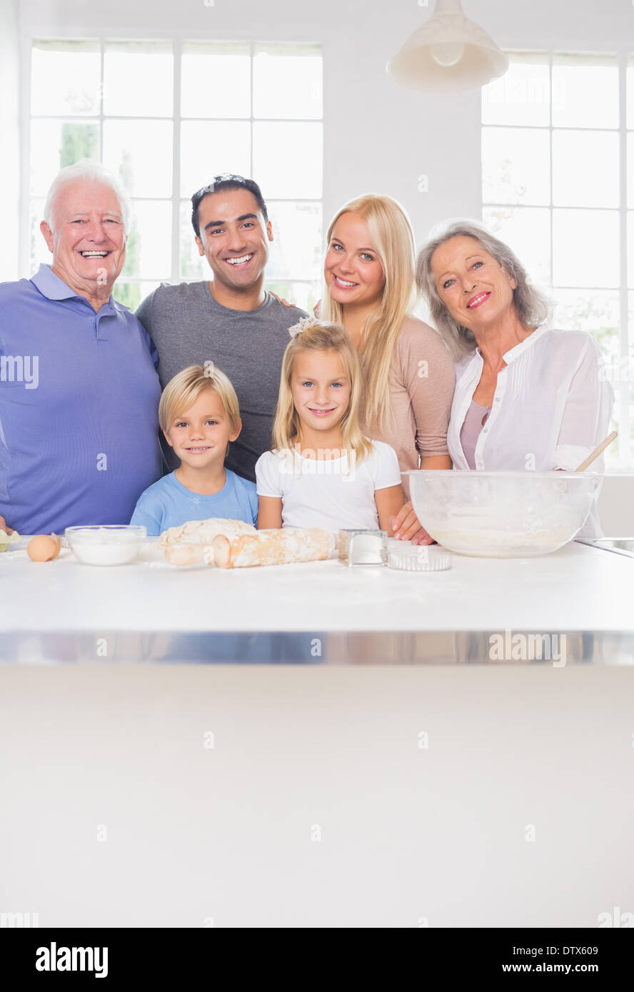 Smiling family posing in the kitchen Stock Photo