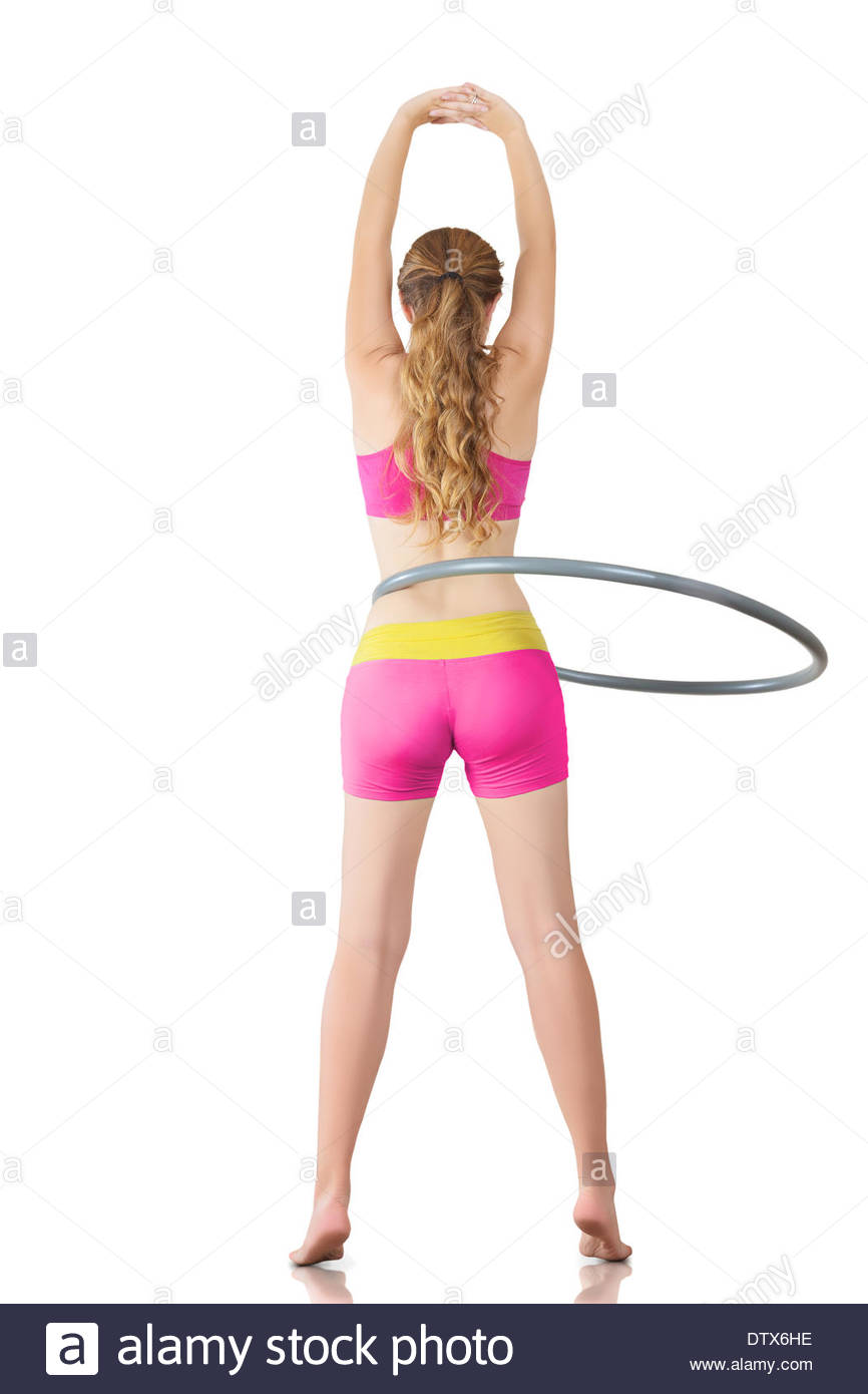 Woman rotates hula hoop - Stock Image