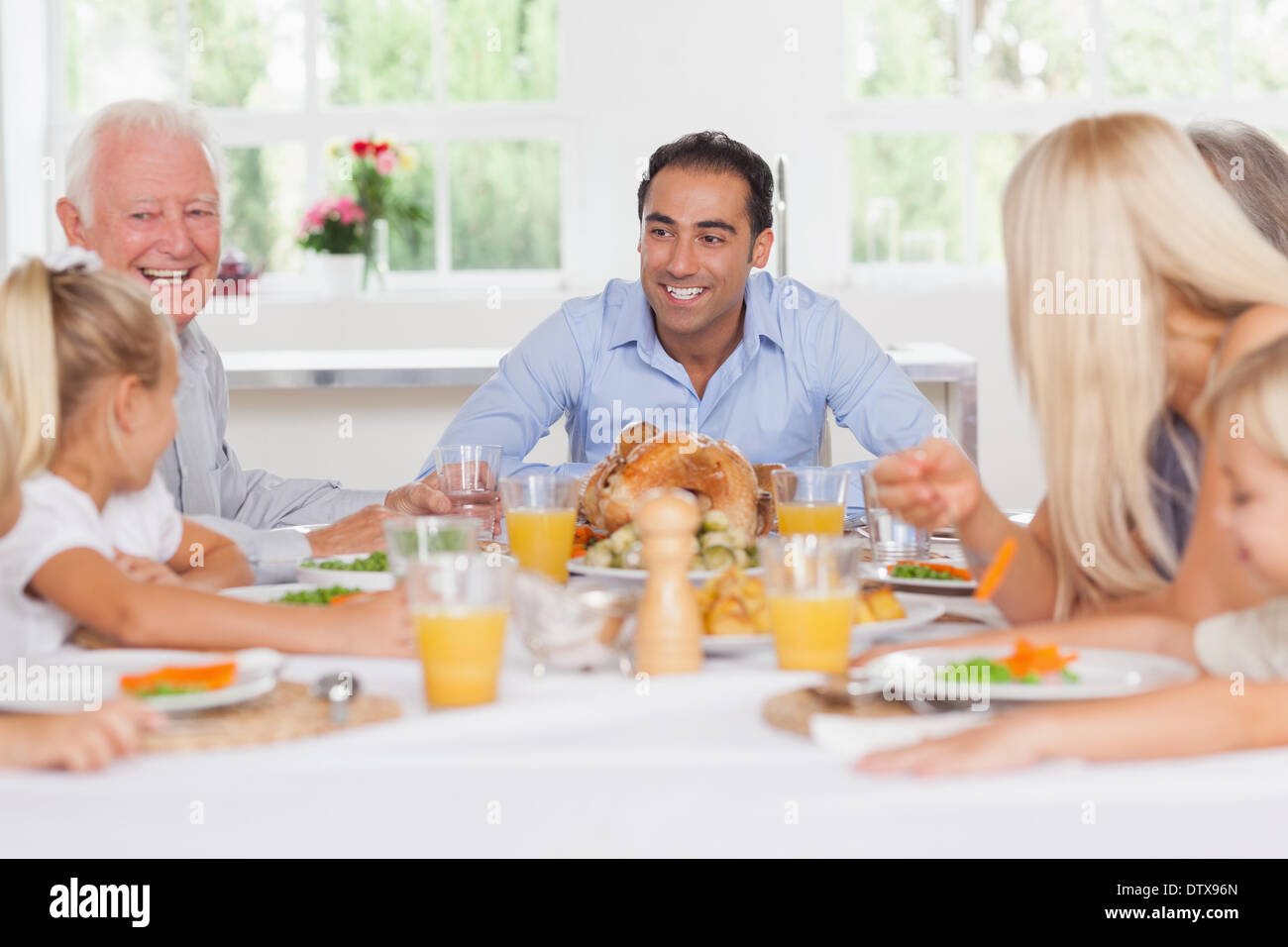 Happy family at thanksgiving - Stock Image