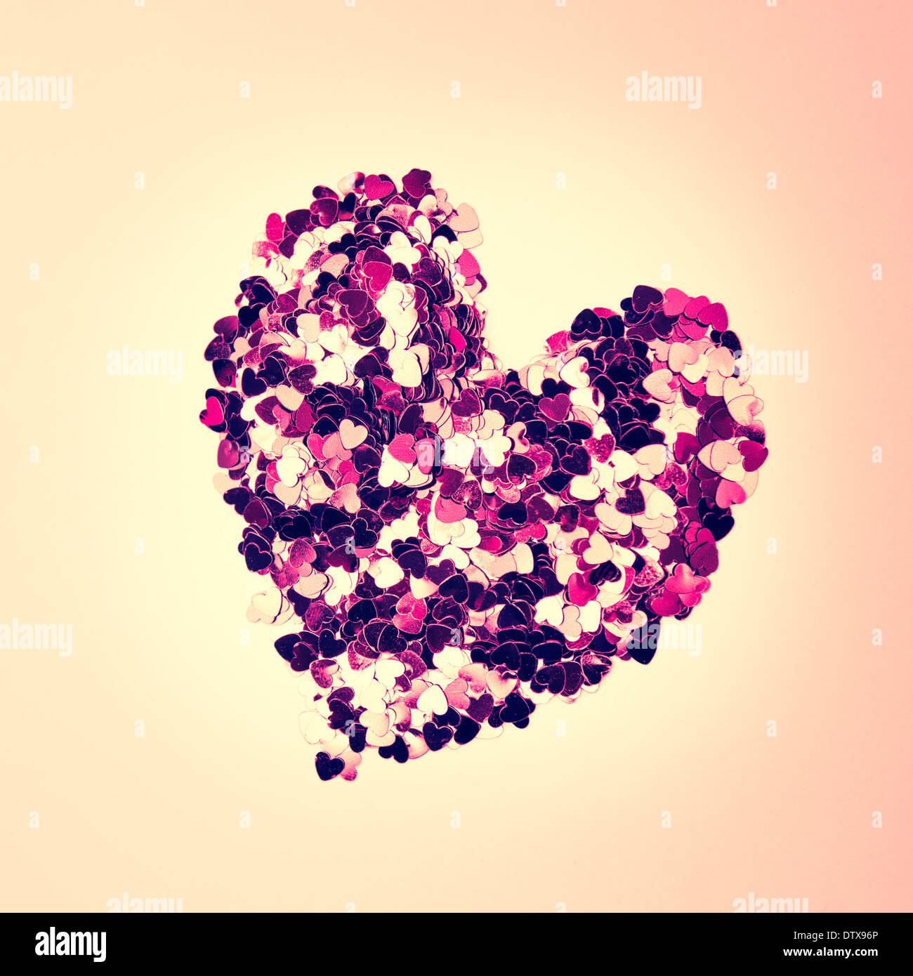 Pink confetti in heart shape - Stock Image