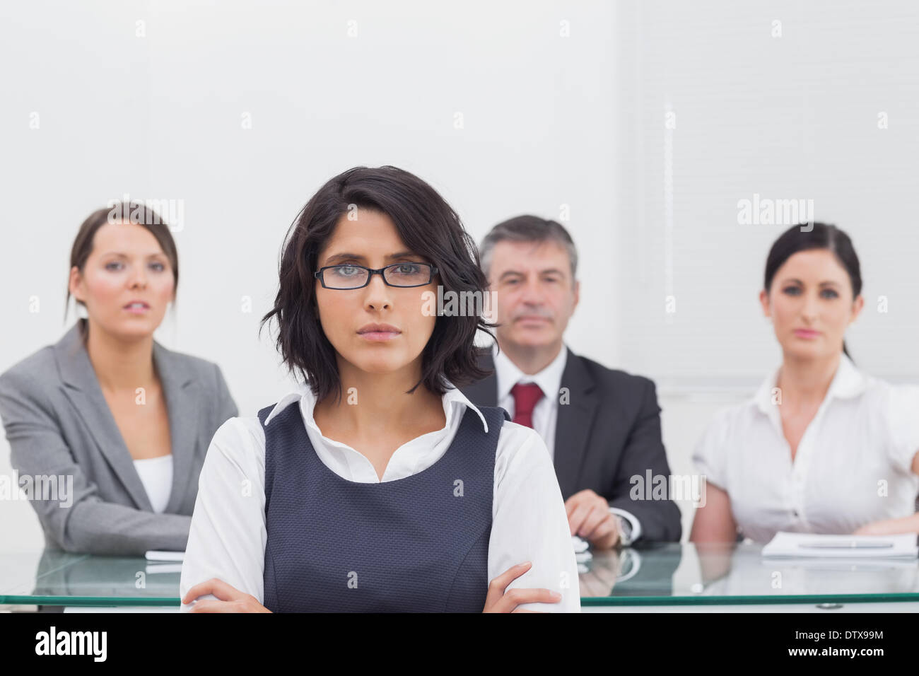 Four business people with serious expressions - Stock Image