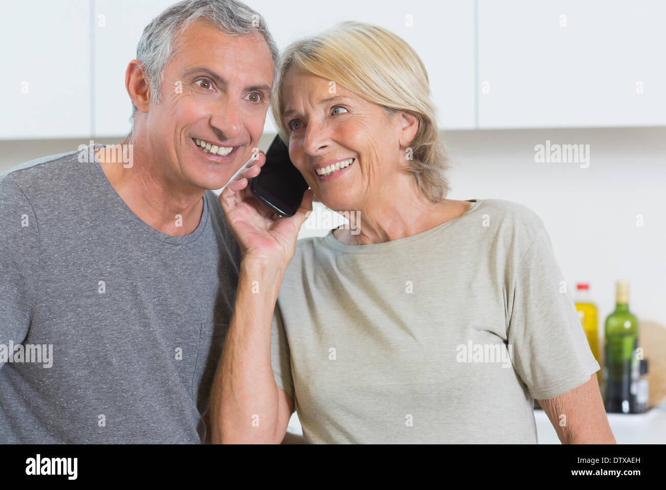 Couple taking a call together - Stock Image