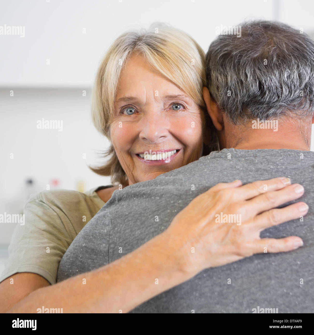 Cute couple embracing - Stock Image