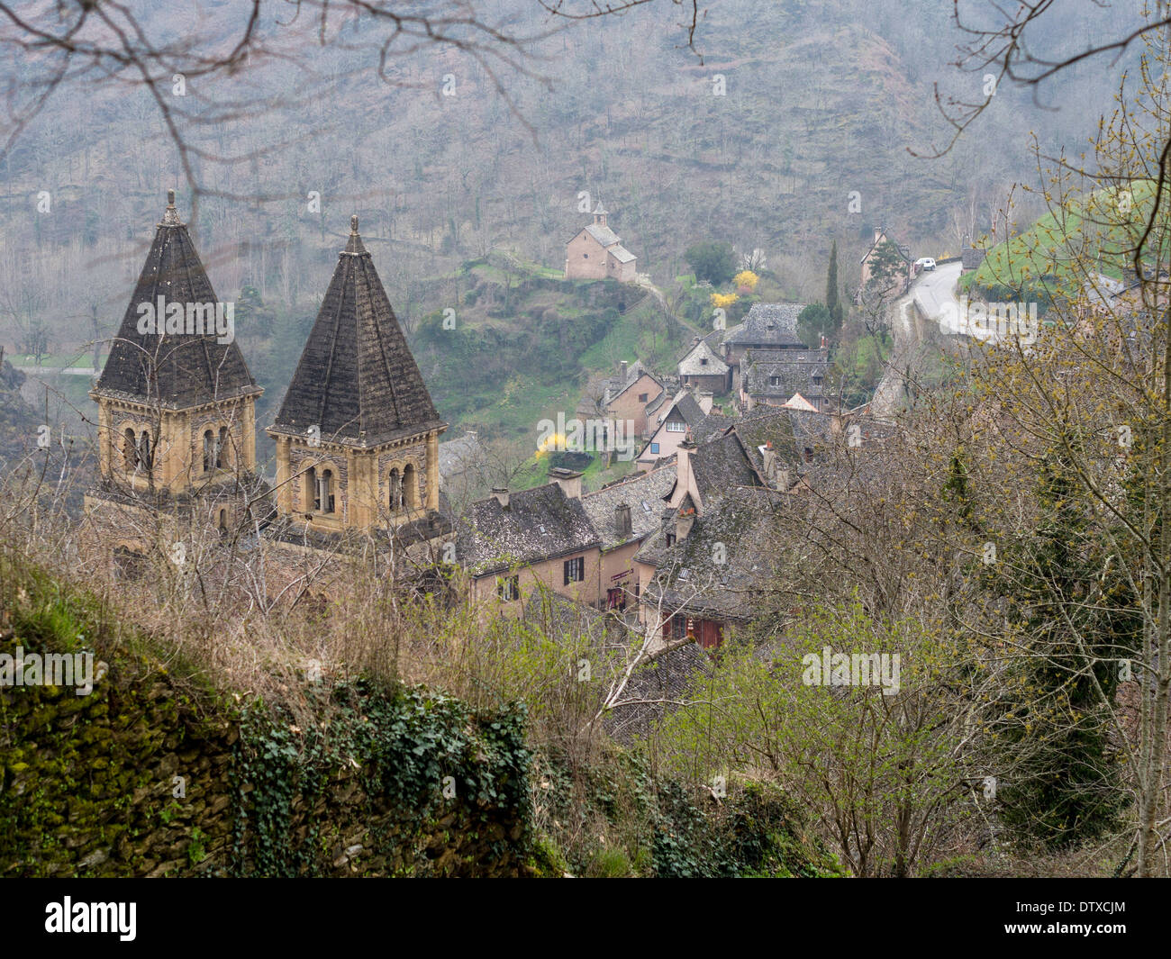 Abbey Church of Saint Foy. Set in the small mountain village of Conques the abbey church is the focal point for the small town. - Stock Image