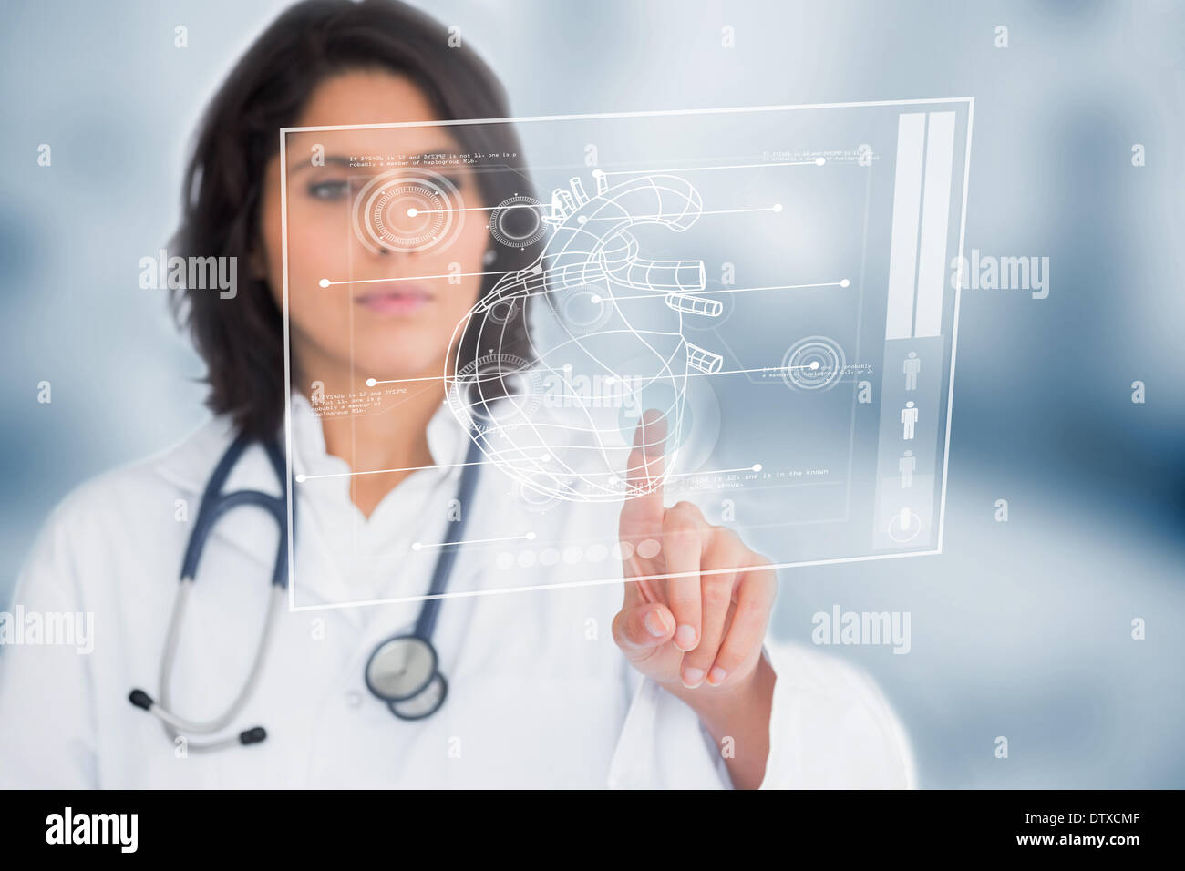 Calm doctor touching a medical interface - Stock Image